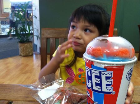 See how she keeps both her candy and drink so close to her person so as not to have to share any of it with fathers.