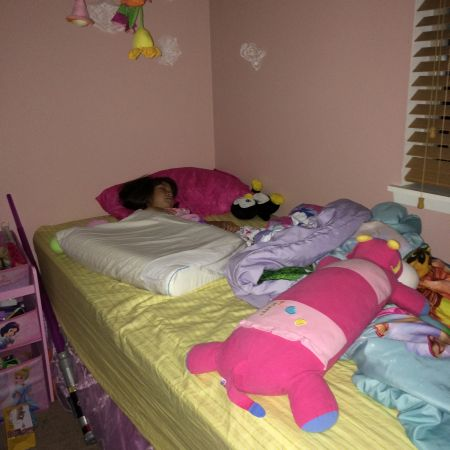 I guess technically, she's not sleeping alone. 47% of her stuffed animal collection cruises bed with her.
