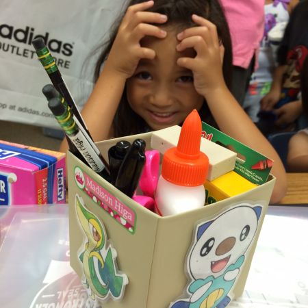She has the coolest utensil box in the school, as far as she's concerned.