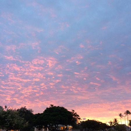 The sun rising on Ala Moana Beach Park.